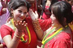 Hindu devotees dance and sing at Pashupatinath Temple while celebrating the Teej festival in Kathmandu