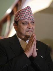 Nepal's deposed King Gyanendra bids goodbye to the media at the end of a news conference at the Narayanhiti royal palace in Kathmandu